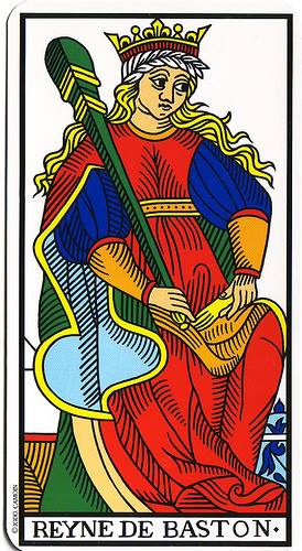 The Queen of Wands from the Camoin/Jodorowski Tarot holds what appears to be a rather massive pen.