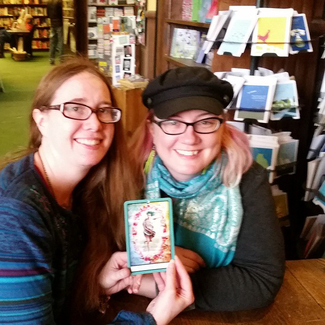 Myself and Theresa Pridemore in early 2015. We are holding The City card from her Portland Tarot.